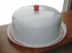 What a beauty this is! Red and white enamelware cake dome.