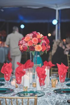 Elegant red and teal table setting and floating rose centerpiece at Callie and Spencer's Coca-Cola Themed Wedding at Georiga Rustic Wedding Venue - Fritz Farm. Jaime Warren Photography