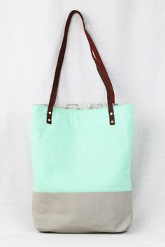 This sturdy and chic mint green and gray tote bag is handmade in Seattle by designer Rouge & Whimsy. Proceeds of each sale go to a children's charity <3 $50