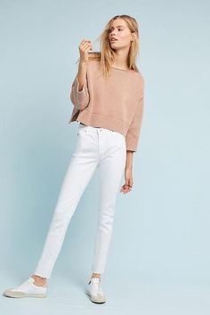 Pair your full-length white jeans with a closed-toe shoe in a lighter, neutral color to keep your look elongated and flattering. Image: Anthropologie