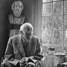 A pensive Carl Jung in front of the bust of Socrates