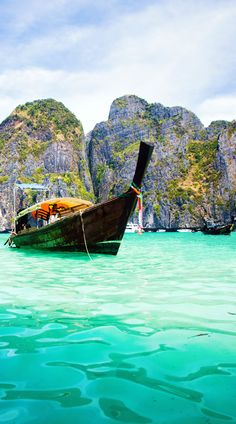 Exotic beach View and traditional Ship in Maya Bay, Ko Phi Phi Don, Thailand | 10 Idyllic Surreal Places that Make Thailand One of the Most Beautiful Country in The World