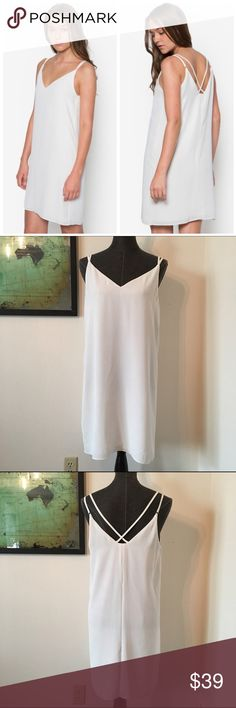 """Topshop White Cross Strap Dress d e s c r i p t i o n  All-over chic white takes this basic slip dress to the next level. Cut with a slinky shape, it features a dainty double cross-strap detailing to the back and a plunging v-neckline. Style with crisp black trainers for a casual feel. NWOT. NO TRADES.  c o n t e n t  100% polyester   33% rayon   4% spandex  m e a s u r e m e n t s ✂️  size + 8   bust + 18""""   length + 33""""    p a i r e  w i t h 🌙  + Eliza J blazer 💵 bundle for a discount…"""