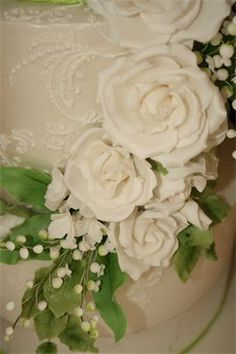 May : Three Tier Wedding Cake with Edible Pure Silver Leaf, Sugar Roses, Lily of the Valley and Hydrangeas.  Finished with hand piped sugar work.