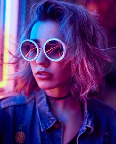 Neon lit shot by Mark Tiu - sun glasses look cool. Could use them in the shoot.