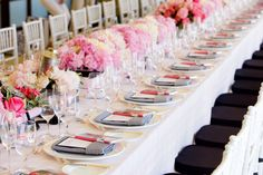 Fabulous table setting for a shower.  Love the row of floral arrangements peppered wit the navy seat cushions and striped napkins.  Lovely.