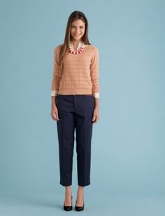 Pale pink open-knit sweater, navy work pants, white blouse, black heels, pink statement necklace (Lucky 19 pieces makes 45)