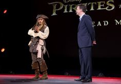 Johnny Depp as Captain Jack Sparrow at D23 to help officially announce Orlando Bloom's return to the Pirates of the Caribbean franchise as Will Turner in Dead Men Tell No Tales