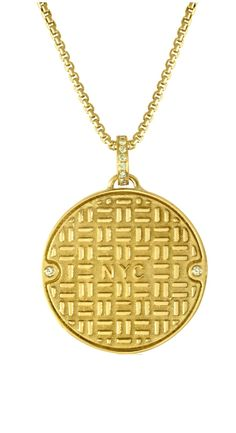 Julie Lamb's NYC Manhole Cover in solid 14K yellow gold with diamonds!