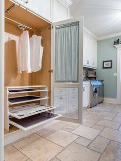 Laundry Room Makeover. This is a huge laundry room but the pull out racks for sweaters and other items to be laid out is genius! Best thing ever for air drying clothes and not stretching them if you don't have a clothesline!
