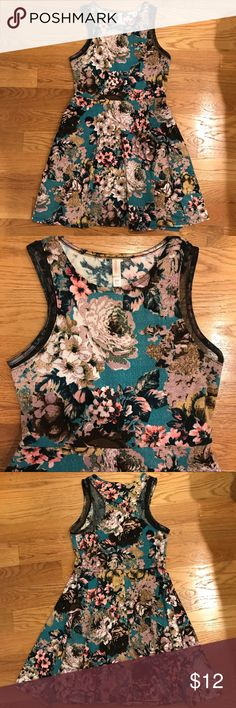 "Floral Skater Dress Xhilaration size medium. Beautiful textured floral print on knit fabric with some stretch. Black mesh sheer panels on front and back bodice. Pull over (no zipper). 34"" long. Very cute for fall with booties! Xhilaration Dresses"