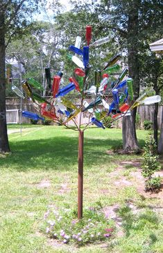 Make your own backyard bottle tree! It's not as hard as it looks!