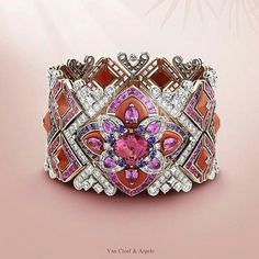 tinahaddadsOlder collection @Regrann from @vancleefarpels - Celebrate the first day of summer with the colorful Summer Cocktail bracelet - pink and purple sapphires, coral and one pink spinel of 10.03 carats. #HighJewelry #PierresdeCaractere #Regrann