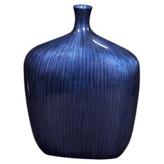 Add an artful touch to your entryway console table or living room mantel with this lovely glass vase, showcasing an arctic blue finish.   ...