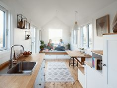 Photo 3 of 1536 in Best Living Ceiling Photos from These Norwegian Tiny Homes Offer Low-Impact Living on Wheels - Dwell Built In Furniture, Normal House, House, Interior, Loft Style Bedroom, Light Hardwood Floors, Wood Kitchen Counters, Wood Kitchen, Tiny House