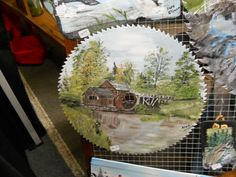 Hand painted scenery on a table saw blade.