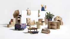 Innovative storage solutions, children's toys and a music amplifier are among the designs made from repurposed cardboard that have been shortlisted in Dezeen and Samsung's Out of the Box Competition. Innovative Packaging, Cardboard Design, Samsung, Cardboard Furniture, Packaging Solutions, Dezeen, Interior Lighting, Design Awards, Innovation Design
