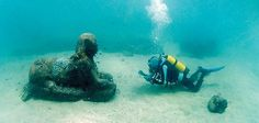 A member of an underwater archaeology team inspects a sphinx that is at least 3,000 years old submerged off Alexandria. (Stéphane Compoint)