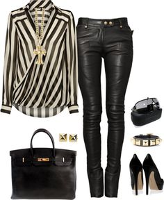 I actually have a shirt a lot like this! I pair it with black crop pants and high heel booties for the perfect work event reception outfit.