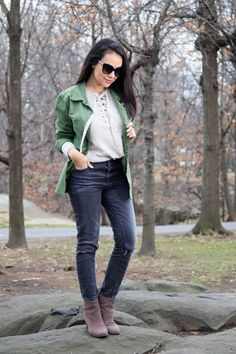 Casual winter outfit. Army green vest with patches. Ripped jeans. Lace-up sweater. Stylishlyinlove.blogspot.com