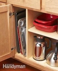 Organization tip for pans and trays.  Mel Notes:  See pan lid drawer under shelf, drawer within a drawer, magnets on cutting boards, knife board on doors