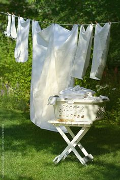 Linen drying on wash line by Sandra Cunningham - Stocksy United Laundry Lines, Laundry Art, Laundry Drying, Doing Laundry, Laundry Hacks, Linen Baskets, Blowin' In The Wind, Stock Imagery, Vintage Laundry