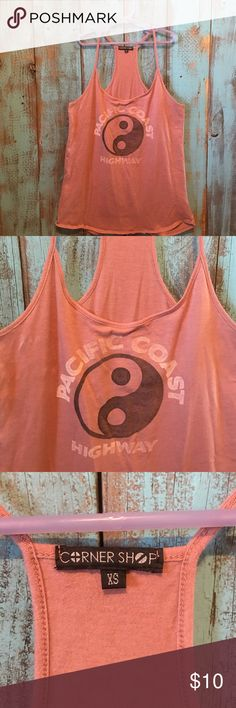 """NWOT / razor back tank / size extra small ADORABLE boutique tank!! New without tags razor back tank. Says """"pacific coast"""" in distress print with the ying and yang symbol.               ------------------------------------------------------------------------------------------No rips, stains or tears! NO TRADES! Smoke free pet free home! Please submit all offers through the offers tab. 😀 Tops Tank Tops"""
