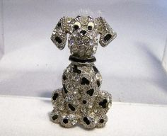Vintage crystal rhinestone dog brooch Rhinestones with black enamel spots Silver tone setting Unsigned 1 3/4 x 1 inch Very good vintage condition, shows no wear,all stones are present I specialize in vintage figural jewelry, please visit my shop for more selections  International buyers welcome, I can ship 3 jewelry items for 12.00 USD, overcharges are automatically refunded prior to shipping Priority shipping is offered 92416  Want to see more great pins? Click here: https://w...