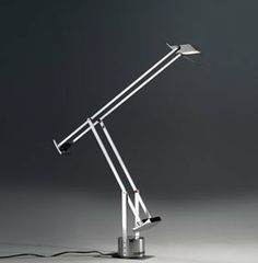 Tizio X30 Table Lamp by Artemide. $705.00. Artemide, Tizio X30 Table LampThe Artemide Tizio X30 Table Lamp, designed by Richard Sapper, is a special edition of the original 1972 Tizio Classic table model, created to celebrate 30 years of design, of light and of the Tizio Xperience (1972-2002). The Tizio X30 features a brilliant finish obtained through the high gloss polishing of the aluminum base, head and arms components and the matching chrome plating of the zinc alloy count...