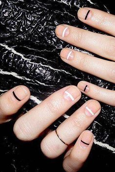 Simple minimal nail art with black and white graphic stipes