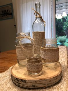 These are 12 ivory lace mason jar sleeves. The burlap and lace is already adhered together. Wine Bottle Centerpieces, Wedding Wine Bottles, Diy Centerpieces, Bridal Shower Decorations, Wedding Decorations, Table Decorations, Diy Arts And Crafts, Diy Crafts To Sell, Vasos Vintage