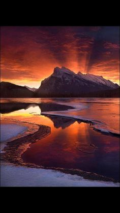 Sunset from Baniff National Park in Alberto, Canada. Photo by Marc Adamus. - Explore the World with Travel Nerd Nici, one Country at a Time. http://TravelNerdNici.com