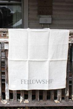 Fellowship linen tea towel by sir/madam with hand written font.