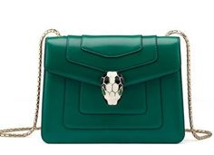 Bulgari Serpenti bag:     Small shoulder bag in leather with light plated and enamel Serpenti closure, with precious snake body shaped chain. One internal large zipped pocket, one small zipped pocket and one open pocket.