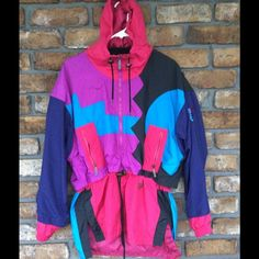 Vintage Tyrolia Ski Wear - NEW LISTING Super Cool ski jacket. It is a pull over shell ... It has a hood, zips up at neckline, a drawstring waist and it longer so it covers the seat area. Has pockets. It is in Excellent pre-loved condition. Only thing I see is a speckle spot in the back. (See pic) Tyrolia Skiwear Jackets & Coats