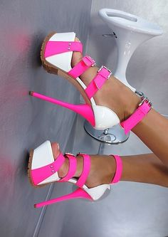 White platform sandals with electric, HOT pink straps and stiletto heels.  Amazing.
