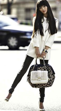 The white coat. The bags. The Leather pants. Love this outfit.