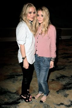 Mary-Kate toned down her black leather pants with a chambray button-down. Ashley styled her Textile Elizabeth and James boyfriend jeans with a cozy pink cardigan and cap-toe ballet flats.