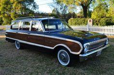 1962 Ford Black Falcon Squire Station Wagon.