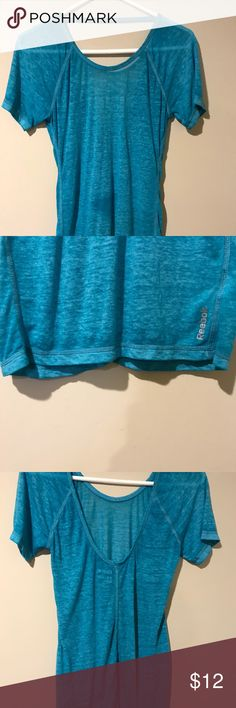 New without tags.  Never worn Rebook top.. Size xs... color is green.  New without tags.  The dark circle of green you see on the front towards the middle is the coloring of the shirt, NOT a stain.  I also have a purple one with the same exact thing that's posted as well.  Both of these tops are super soft material and super cute just not my style. Reebok Tops Tees - Short Sleeve