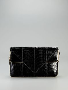 Great for any and every occasion! LOVE! ( Carla Watersnake Triangle Clutch by Brian Atwood )