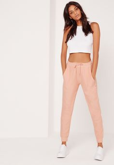 Channel that sweet and innocent day look and spice up your closet in these dusky pink joggers. Featuring cuffed ankles, elasticated waistband with tie fasten and loopback stitching, you need to snap these up fast! Team with a basic jersey t...