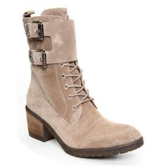 This military inspired boot is glammed up with bold hardware for a touch of chic. The DANTI is perfectly designed to accent your cool weather look. The padded footbed ensures walking comfort.<br /><ul><li>Oily suede upper</li><li>Side zipper for easy wear</li><li>2 ½ inch stacked heel</li><li>Rubber sole</li><li>Imported</li></ul>