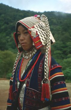 Asia | Portrait of a Pamee Akha woman with traditional headdress with silver coins,Thailand | © Jim Goodman