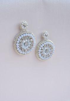 White Wedding Crystal Earrings $60 For more beautiful earrings click here:www.etsy.com/shop/Rozenhandmade #weddingearrings #bridal #etsyfinds