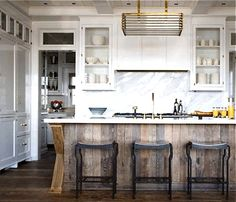 Love this kitchen island, but I would do warmer colors... like a soft yellow or peach with more cherry colored woodwork.