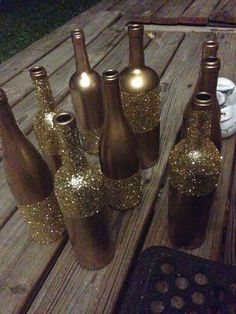 Metallic gold spray paint and I waited about a week to do the glitter... Modge podge adhesive from the craft store and an inch foam paint brush and just sprinkled glitter on them until completely covered by RioLeigh
