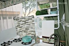 Easy Pop Up Camper Tile Backsplash - The Pop Up Princess Camper Hacks, Camper Ideas, Camper Wallpaper, Coleman Pop Up Campers, Pop Up Princess, Camper Kitchen, Smart Tiles, Tile Covers, Rv Makeover