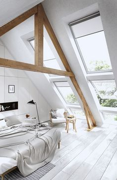 All white isn't boring in this stunning attic space! The exposed wooden beams…