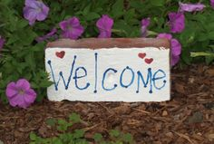 """Inviting hand made garden brick with """" Welcome """" written on it. Perfect for placing in your garden or walkway to let everyone know how friendly your home is. Each brick is hand painted so there may be slight variations from brick to brick"""